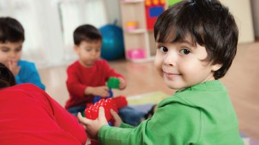 Toddlers with Duplo blocks. Image credit: iStock