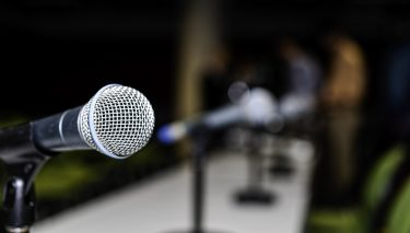 Microphones on a table. Image credit: iStock
