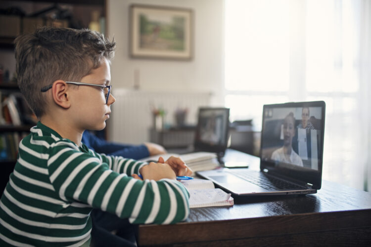 Elementary student using computer for distance learning. Image credit: iStock