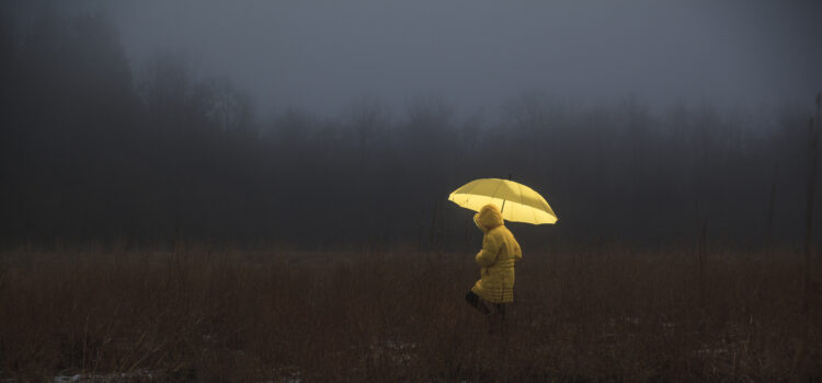 Little girl crossing the field in fog. Image credit: iStock