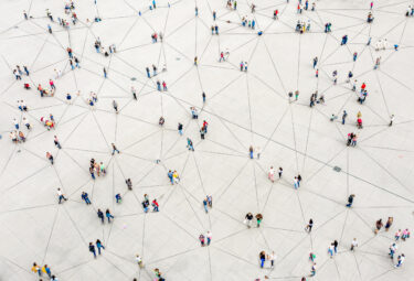 Aerial view of crowd connected by vectors. Image credit: iStock