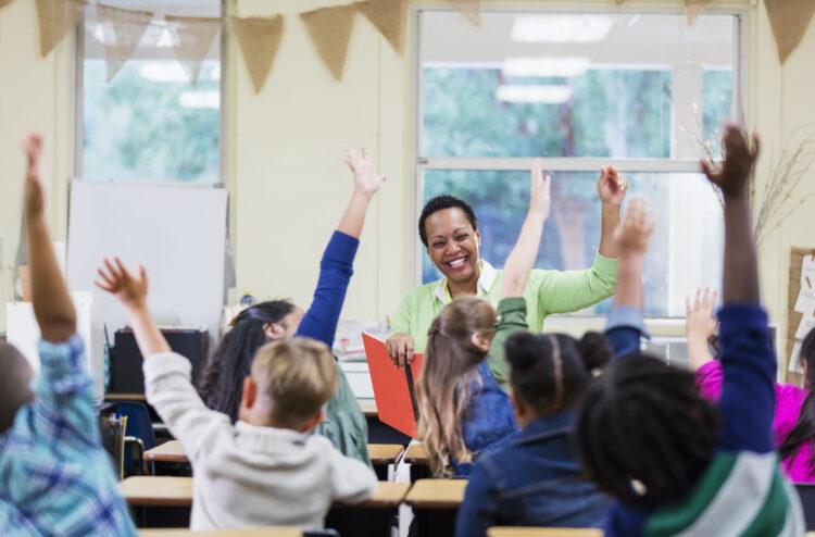 African-American teacher reading to school children. Image credit: iStock